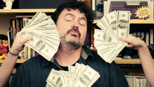 It takes a lot of extra backer money to make fans that large to cool the searing ego of Tim Schafer!